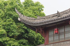 Chinese traditional building detail against trees Stock Photo