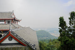 Chinese traditional building on mountaintop against sunny aftern Stock Photo