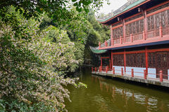 Chinese traditional building by river in spring Stock Image