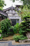 Chinese traditional building in verdant green on rainy day Stock Images