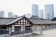 Chinese traditional buildings in modern city on foggy winter day Stock Photos