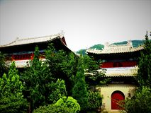 Chinese traditional buildings, trees and sky royalty free stock photo