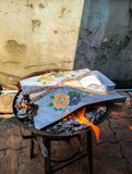 Chinese traditional for burning the fake clothes paper to passed away ancestor`s spirits stock photos