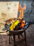 Chinese traditional for burning the silver and gold money paper to passed away ancestor spirits. Chinese traditional for burning the silver and gold money paper royalty free stock photo
