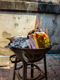 Chinese traditional for burning the silver and gold money paper to passed away ancestor spirits. Chinese traditional for burning the silver and gold money paper stock photo