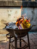Chinese traditional for burning the silver and gold money paper to passed away ancestor spirits. Chinese traditional for burning the silver and gold money paper royalty free stock image