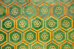 Chinese traditional ceramic tile. With abstract flower pattern ceiling background Royalty Free Stock Images