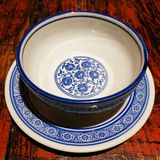 Chinese china Rice Bowl and Dish. A Chinese traditional china dinner bowl and dish with blue pattern on a wooden desk stock image