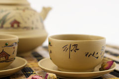 Chinese traditional clay tea set. Chinese traditional clay teapot and cups of tea on bamboo mat Stock Photos