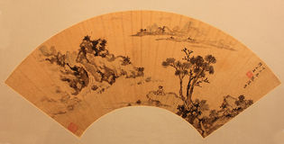 Chinese traditional folding fan. Famous painting or writing on it stock photo