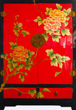 Chinese traditional furniture. The Chinese traditional cupboards with peony pattern Stock Photography