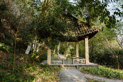 Chinese traditional gazebo in woods of sunny winter afternoon Stock Images
