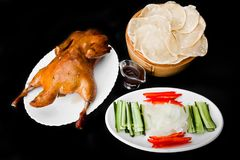 Pkin duck with vegetables and bread cheeps. Chinese traditional grill Pekin Duck spicy hot sauce with fresh vegetables comber sweet red pepper onion and bread Royalty Free Stock Image