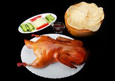Pkin duck with vegetables and bread cheeps. Chinese traditional grill Pekin Duck spicy hot sauce with fresh vegetables comber sweet red pepper onion and bread Stock Photography