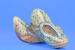 Chinese traditional ladies Shoes. On blue background Royalty Free Stock Photos
