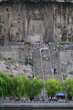 Longmen Grottoes caves with Buddhas figures in Luoyang, China. Royalty Free Stock Photography