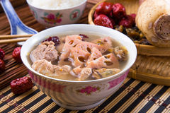 Chinese traditional lotus root soup. With pork meat and red dates Stock Photo