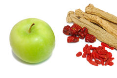 Chinese traditional medicine and a green apple Royalty Free Stock Photo