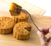 Chinese traditional mooncake , hand and  fork Stock Image