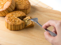 Chinese traditional mooncake , hand and  fork Royalty Free Stock Images