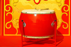 Chinese traditional red wooden drum with drumsticks Stock Photo
