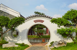 Chinese round gate in backyard landscaping garden. Asian Chinese traditional round gate in oriental ancient style in Chinese classic ancient backyard landscaping royalty free stock images