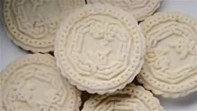 Chinese traditional Stir fired biscuit rotating the Chinese words on top means Chinese chestnut. Chinese traditional Stir-fired biscuit rotating the Chinese stock video