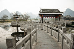 Chinese Traditional Stone Bridge at Shangri-La Guilin, Guilin. Shangri-La Guilin is located 15 km north of Yangshuo and 50 km south of Guilin city. It is a Stock Photo