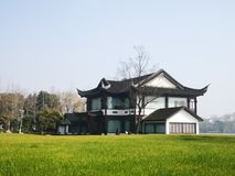 Chinese traditional style house with lawn royalty free stock photo