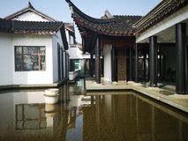 Chinese traditional style house with lawn stock photography