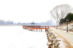 Chinese traditional style wooden bridge in the snow Stock Images