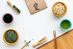 Chinese traditional symbols concept. Tea, rice, hieroglyph love, bamboo table mat, chopsticks, soy sause on white. Background top view royalty free stock photography