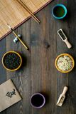 Chinese traditional symbols concept. Tea, rice, hieroglyph love, bambootabe mat, chopsticks, soy sause on dark wooden. Background top view frame stock photography