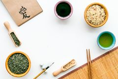 Chinese traditional symbols concept. Tea, rice, hieroglyph love, bambootabe mat, chopsticks, soy sause on white. Background top view royalty free stock image