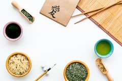 Chinese traditional symbols concept. Tea, rice, hieroglyph love, bambootabe mat, chopsticks, soy sause on white. Background top view royalty free stock photography