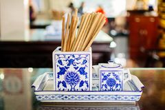 Chinese traditional tableware. Chopsticks and bottle Royalty Free Stock Images