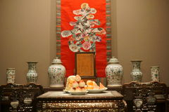 "Chinese traditional way to celebrate birthday. On the table are peaches. On the wall is character ""Longevity"" Stock Photos"