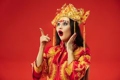 Chinese traditional woman. Beautiful young girl wearing in national costume stock photo