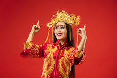 Chinese traditional woman. Beautiful young girl wearing in national costume stock image