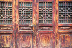 Traditional wooden door with lattice window Stock Photo