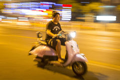 Chinese traveling with his motorcycle Stock Photo