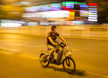 Chinese traveling with his motorcycle Stock Image