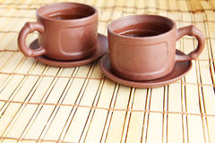 Chinese two cups and tea. Chinese clay two cups and green tea Royalty Free Stock Photos