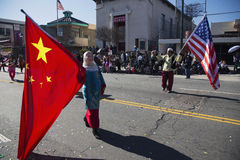 Chinese and U.S. flags at Chinese New Year parade, 2014, Year of the Horse, Los Angeles, California, USA Royalty Free Stock Photos