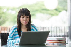 Chinese University student studying at her campus. Stock Images