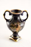 Chinese vase. Small chinese vase, gold painted isolated on white background Stock Images