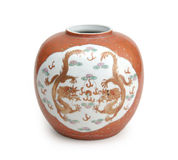 Chinese Vase. Vintage chinese vase with dragon art on a white backdrop Stock Photo