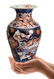 Chinese vase hand-held in white background. Chinese vase hand-held on white background Stock Photos