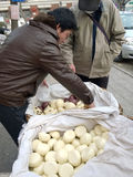 Chinese vendor selling steam bread. Vendor selling steam bread  at community Tianjin university Tianjin China photoed on February 28th 2014 Royalty Free Stock Images