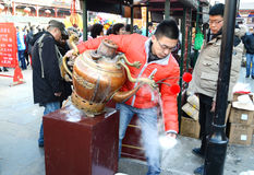 Chinese vendor selling  traditional local snacks. A vendor is making Chinese traditional local snacks at culture street Tianjin China photoed on february 4th Stock Photo